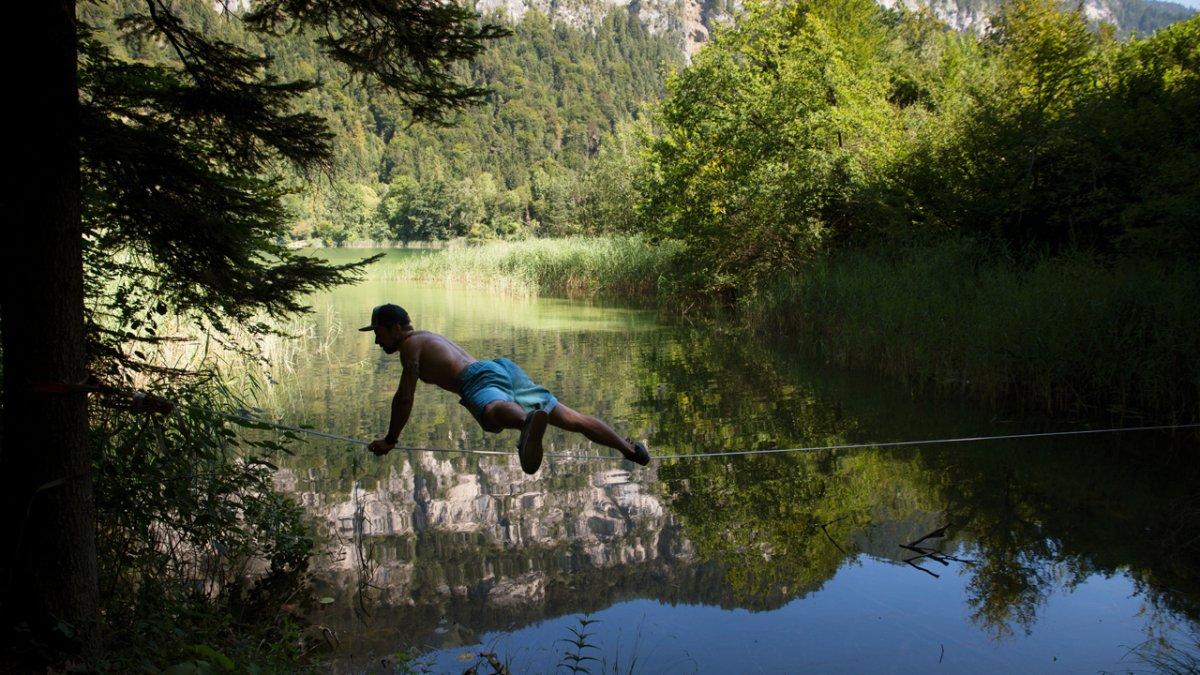 Slackline sul lago di Reintaler See, © Tirol Werbung/Bert Heinzlmeier